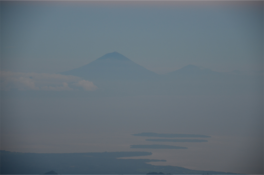 Mount Agung (left), Mount Batur (right) and the Gilis (foreground)