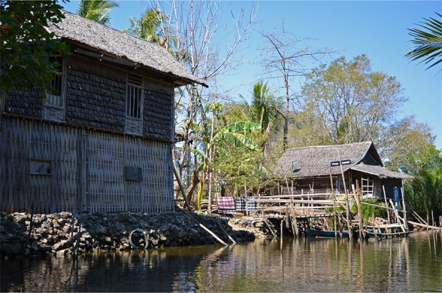 Thatched bamboo houses by the river