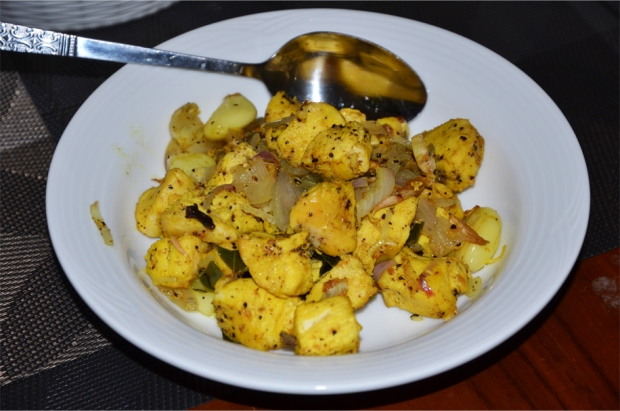 Chicken cooked with pepper, clove, curry leaves, red onion and garlic - also by Achini