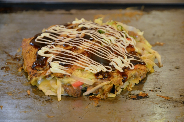 Grill-it-yourself okonomiyaki, topped with a sweet-savoury sauce and mayonnaise
