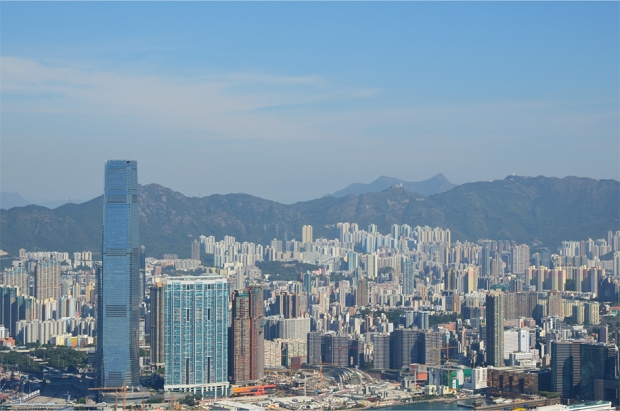 The skyscrapers of Kowloon, with Ma On Shan's distinctive saddle just over the ridge