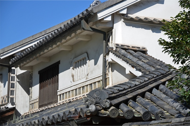 Cascading roof tiles that culminate in a fan