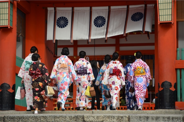 Kimono-clad teenagers at Fushimi Inari-taisha, a popular shrine