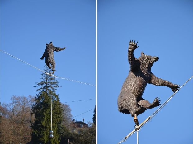 A comical bear on a tightrope