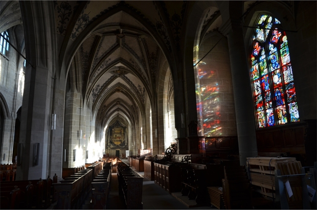 Stained glass brings welcome bursts of colored light into the rather bare interior